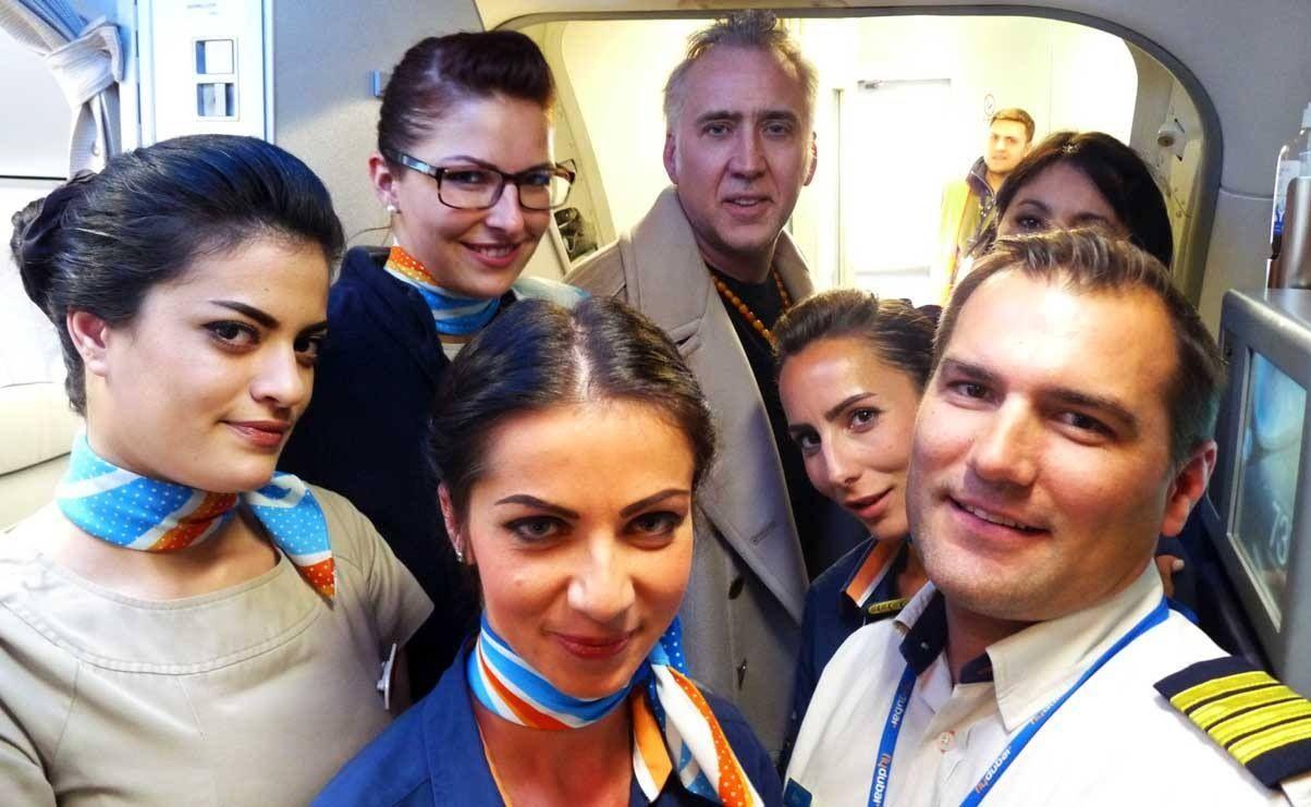 Award winning actor Nicolas Cage on a flight from Bucharest
