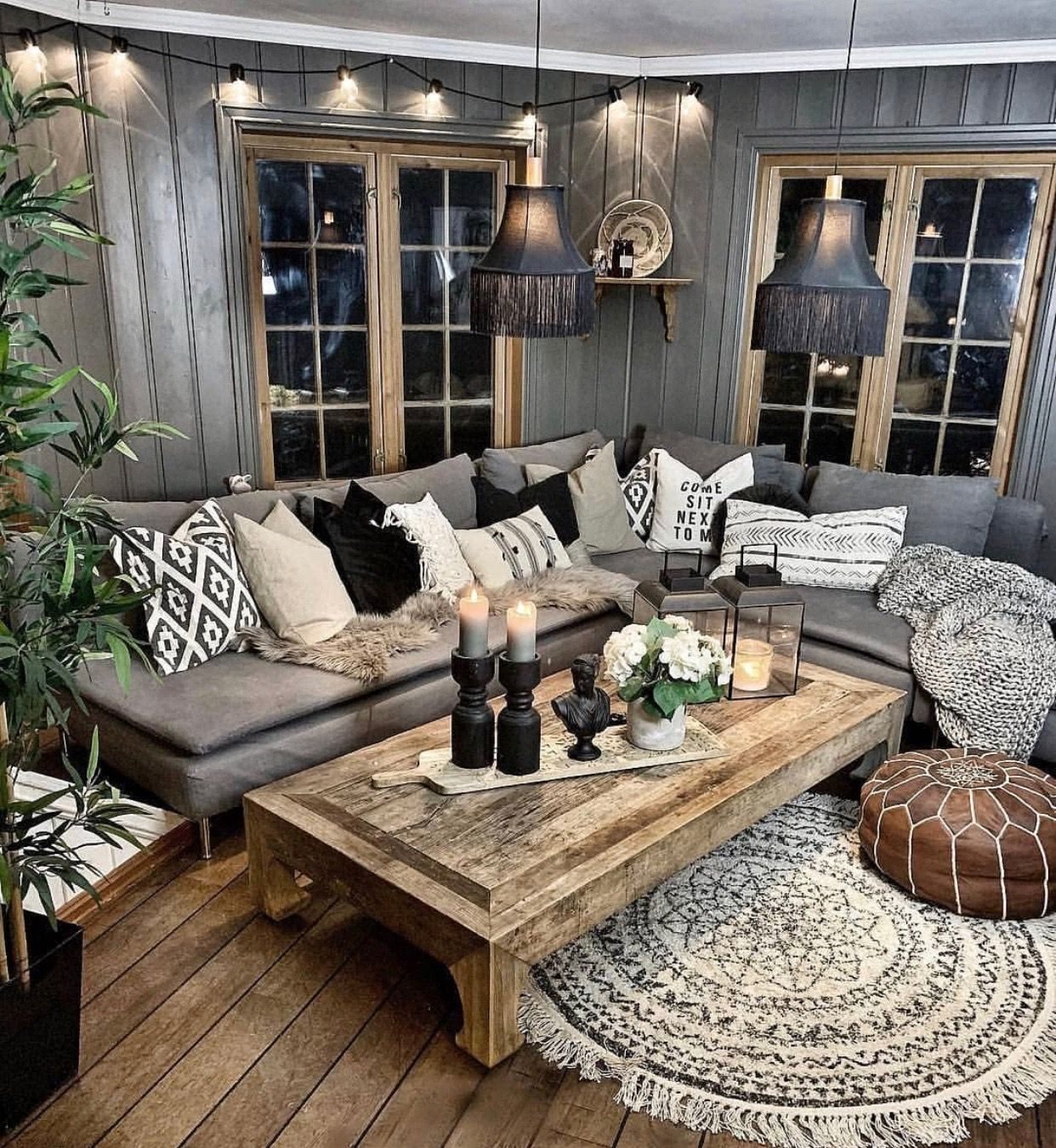 The sectional with pillows (not the colors) and the coffee table are cozy and a relaxing area made for a living room.