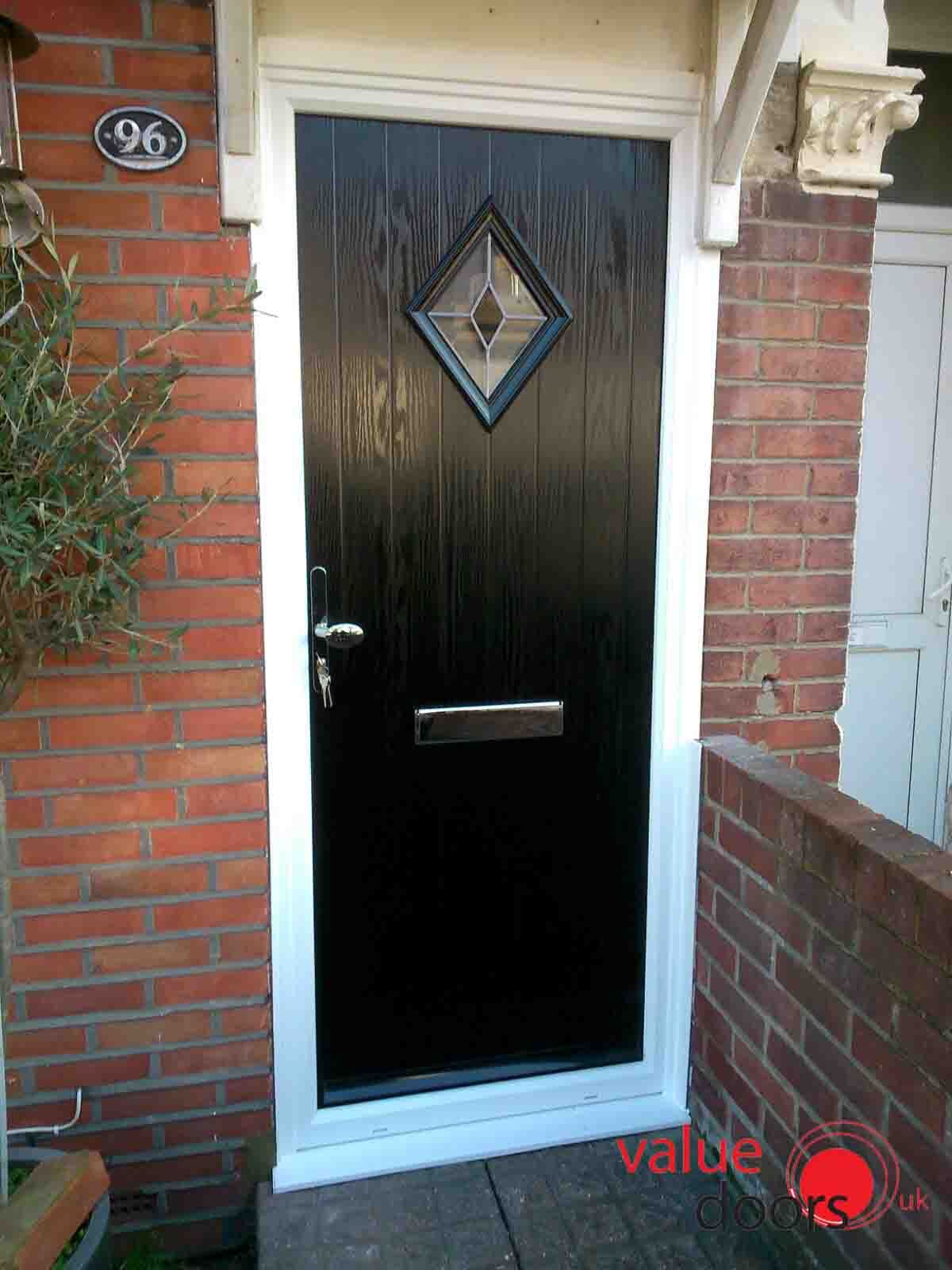 Black Doors in a white frames make such a beautiful entrance to any ...