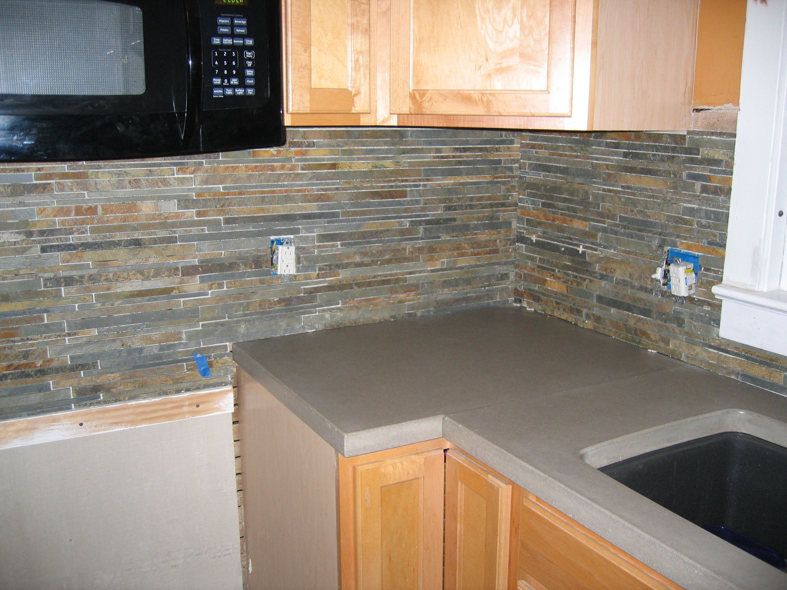 Slate backsplash slate tile kitchen we went with slate for Glass instead of tiles in kitchen