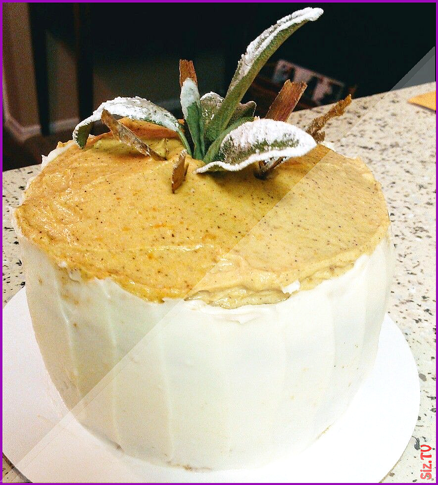 My home-made Pumpkin Pie Mini Cake with cream cheese frosting granished with fresh sugar sage and c