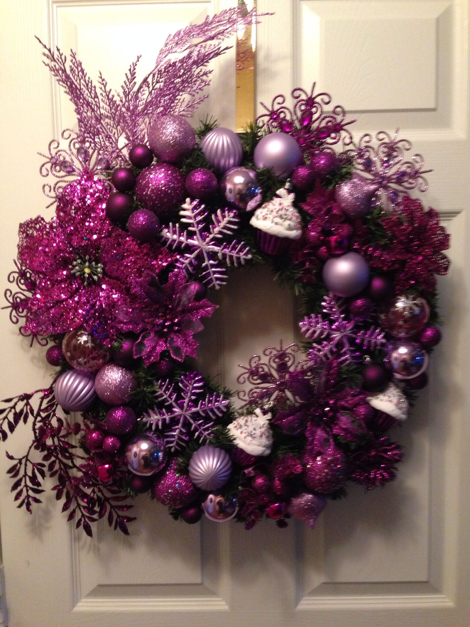 made this purple lavender snowflake n cupcakes christmas wreath 2dayall decorations from ww n the purple poinsettia is from family dollarthis is for