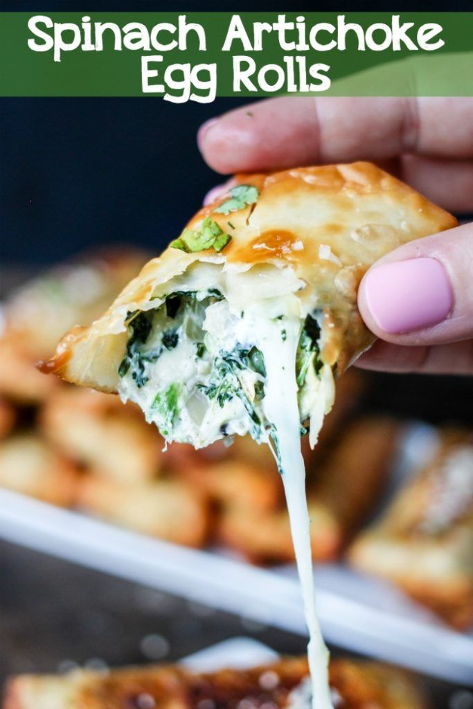 Your favorite Creamy Spinach Artichoke Dip is stuffed into egg roll wrappers and quickly fried to make these mouthwatering Spinach Artichoke Egg Rolls! #eggrolls