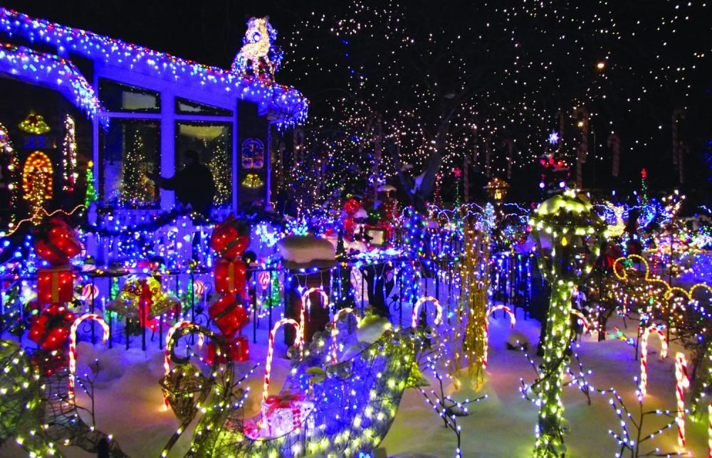 This Colourful Home Is Located In Edmonton Alberta The Owner Adds More L Best Christmas Lights Best Christmas Light Displays Decorating With Christmas Lights
