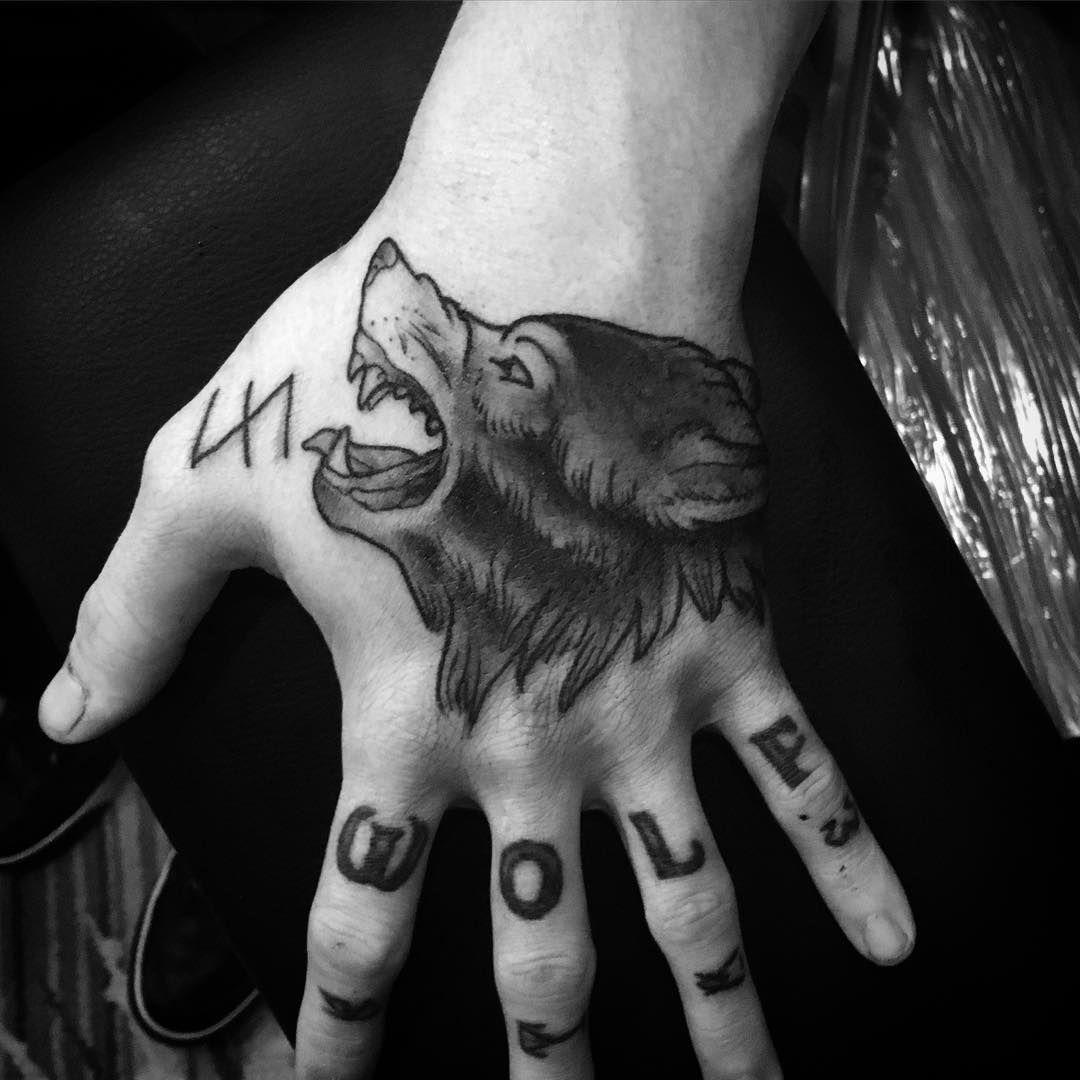 Wolfs hook tattoo