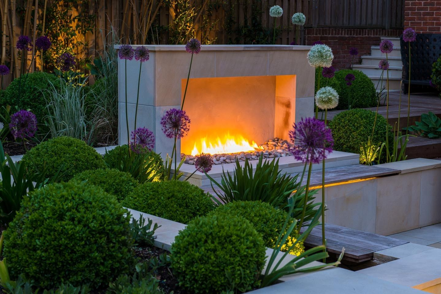 A garden for outside use all year with an exterior gas fireplace