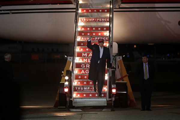 Donald Trump Photos Photos - Republican presidential nominee Donald Trump steps off of his airplane after arriving for a campaign rally at Pittsburgh International Airport November 6, 2016 in Moon Township, Pennsylvania. With less than 48 hours until Election Day in the United States, Trump and his opponent, Democratic presidential nominee Hillary Clinton, are campaigning in key battleground states that each must win to take the White House. - Donald Trump Campaigns in Key States During…