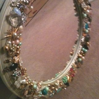 Made this mirror frame w/antique costume jewelry