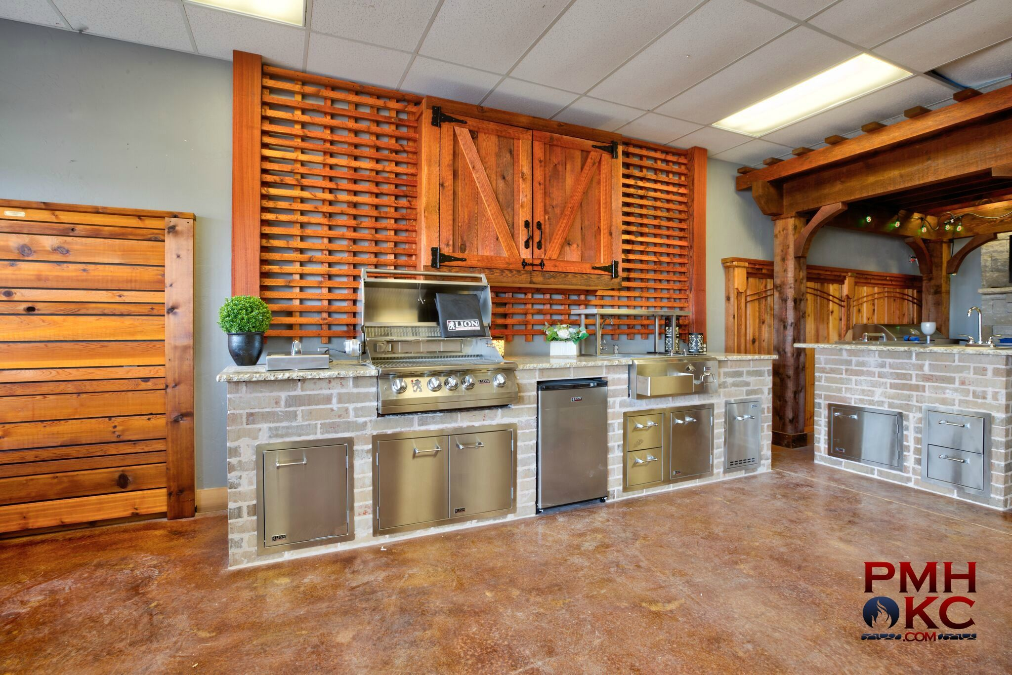 custom outdoor kitchen example in our showroom kitchen with lattice wall and tv box with on outdoor kitchen tv id=85794