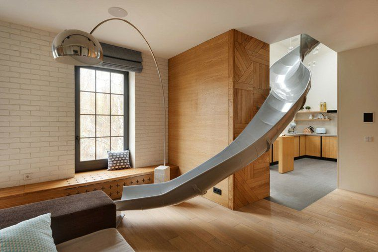 Appartement design avec toboggan intérieur par ki design studio