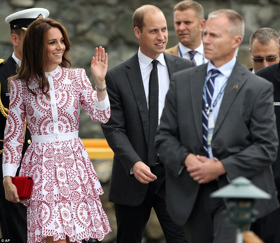 William and Kate are escorted to the sea plane terminal in Victoria Harbour as they board a flight to Vancouver on Thursday