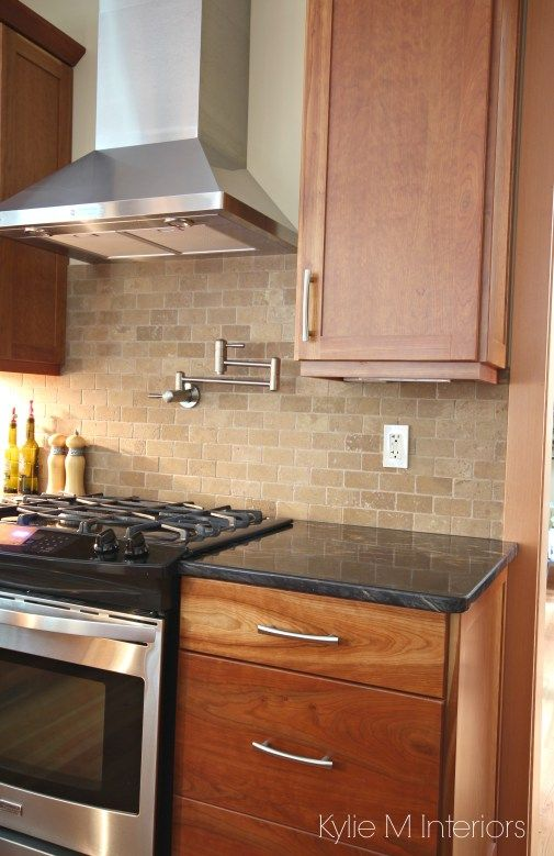 Kitchen Backsplash For Black Granite Countertops natural cherry cabinets, travertine tile backsplash, black granite