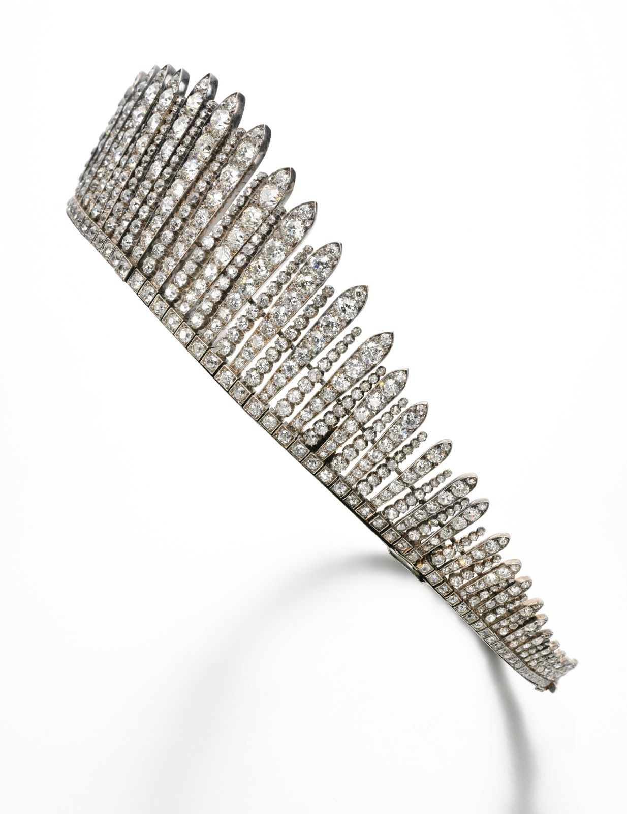 "Side view of tiara from the Collection of the Earl of Mar and Kellie. A diamond tiara/necklace, designed in the style of a ""tiare russe,"" dating back to the 1880s and drawing inspiration from the Russian kokoshniks—traditional fan- shaped head ornaments inspired by the cockscomb. This tiara was worn by the 12th Countess of Mar at the coronation of King Edward VII in 1902 (estimate: $150,000 – $295,000)."