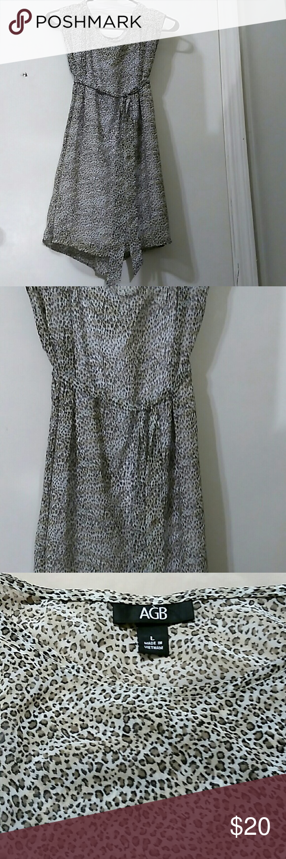 Leopard Chiffon top NWOT Leopard Chiffon top.. comes with a leopard belt or u can wear it flowy AGB Tops Blouses