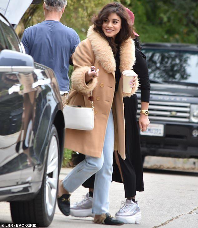 Vanessa Hudgens wears tan coat with furry collar at photo shoot in LA