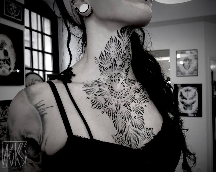 Abstract neck chest tattoo for Chest and neck tattoos