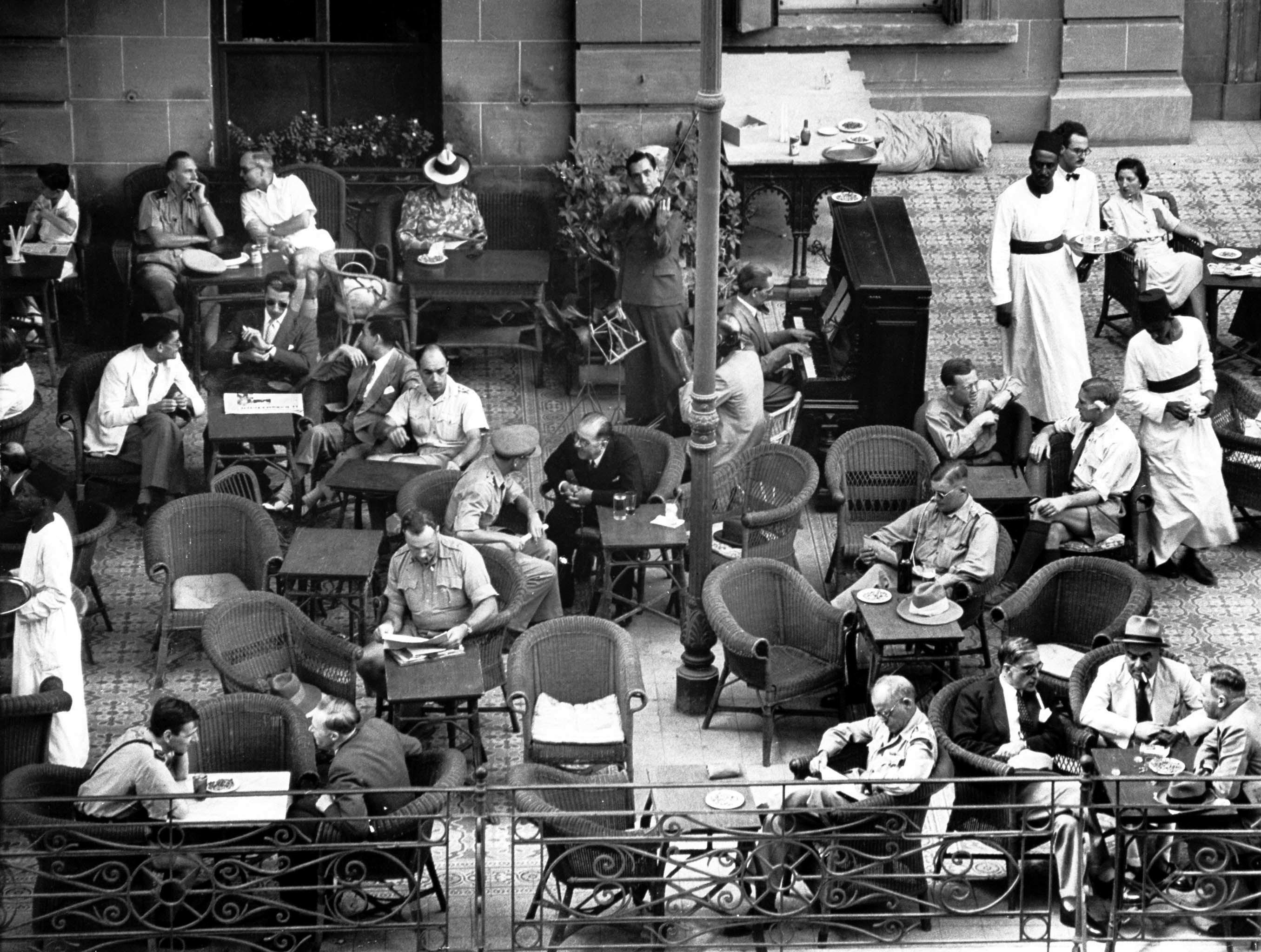 Shepherd's terrace, many allied officers relaxing. 1942 Bob Landry | Cairo, Shepheard's  hotel, Old egypt