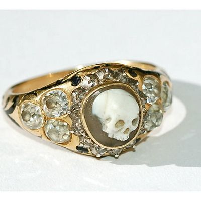 """18k gold with a carved agate skull surrounded by rose- and old-cut diamonds and black enamelling, with hallmarks for London 1852.  It has an interior inscription on the ring that adds another fascinating layer of history: Inscribed """"James Dixon Obit 1852,"""" it memorialises James Dixon, a well-known English silversmith and founder of the family firm of James Dixon & Sons."""