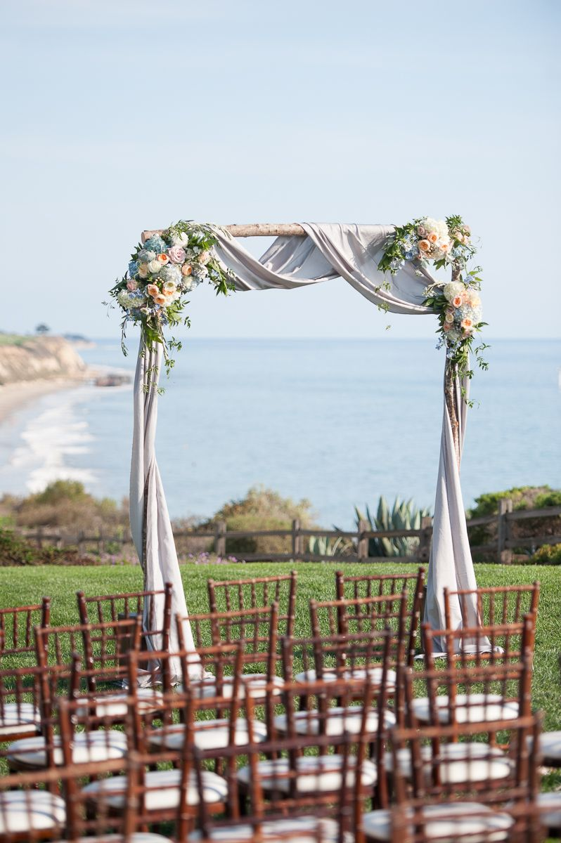Arbor Birch Pole Wedding Ceremony Arch With Peach And Blue Flowers Grey Draping