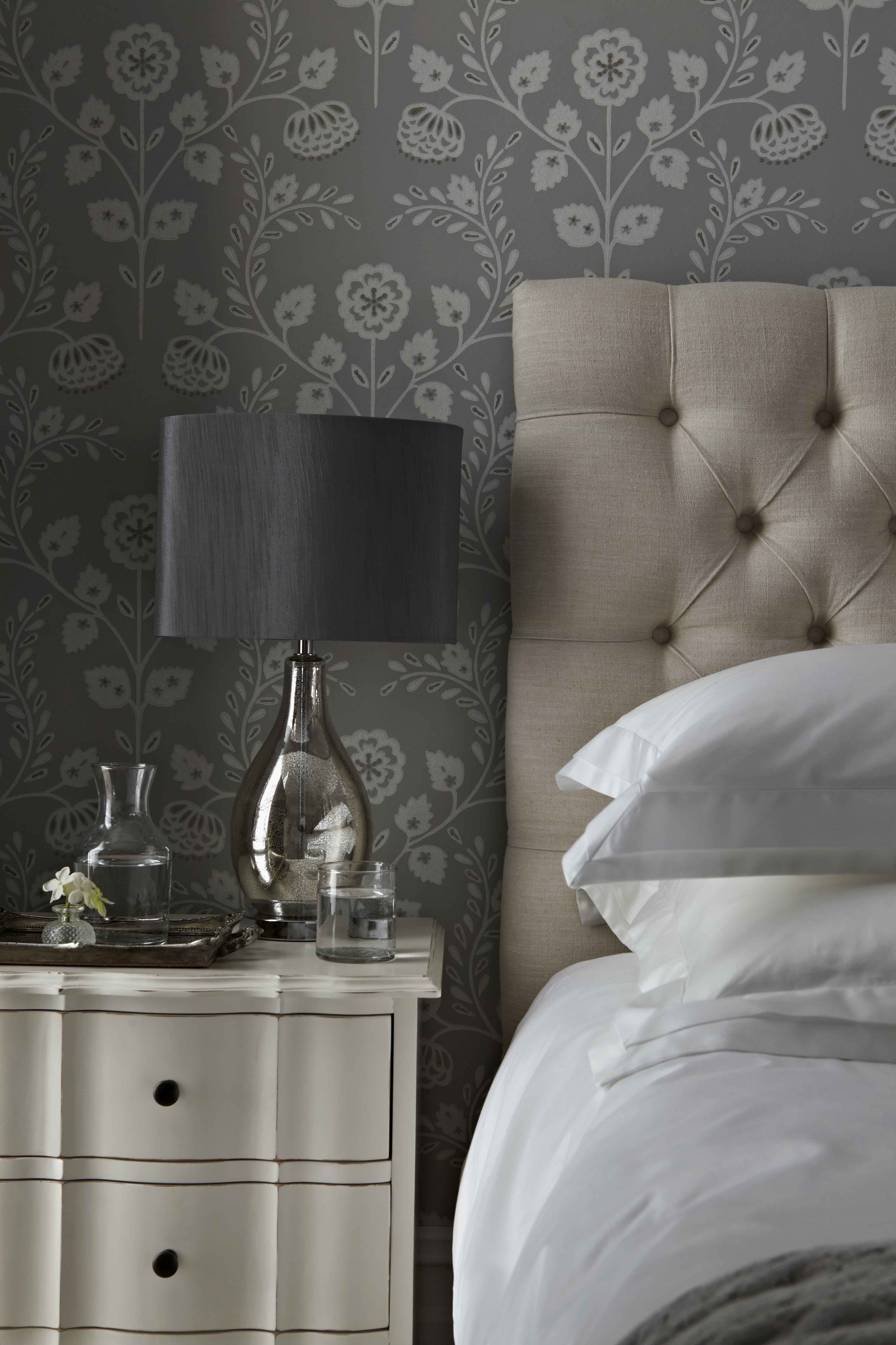 Combine a deep buttoned headboard with soft french