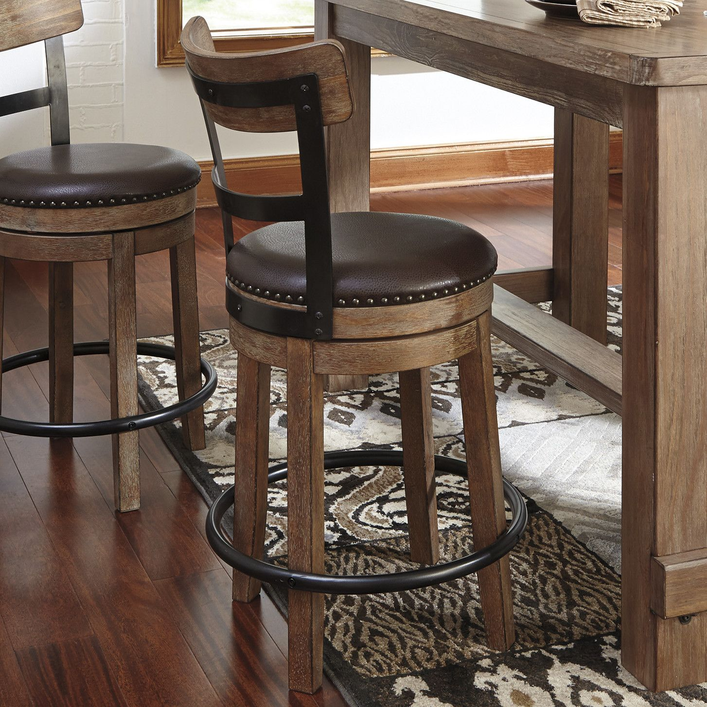 The Pinnadel Contemporary Barstool In A Brown Finish Will