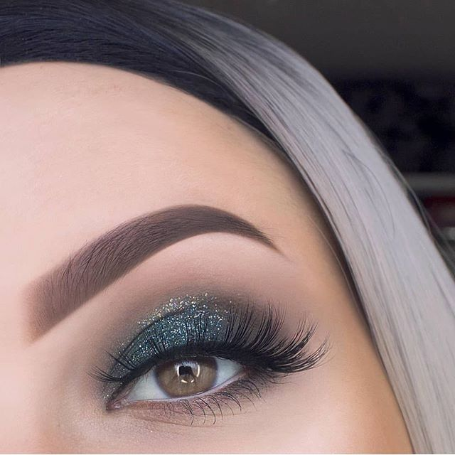 Shimmery blue green eye makeup