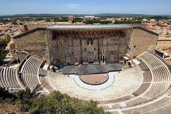 """The Théâtre antique d'Orange (""""Ancient Theatre of Orange"""") is an ancient Roman theatre, in Orange, southern France, built early in the 1st century CE.  It is owned by the municipality of Orange and is the home of the summer opera festival, the Chorégies d'Orange.It is one of the best preserved of a..."""