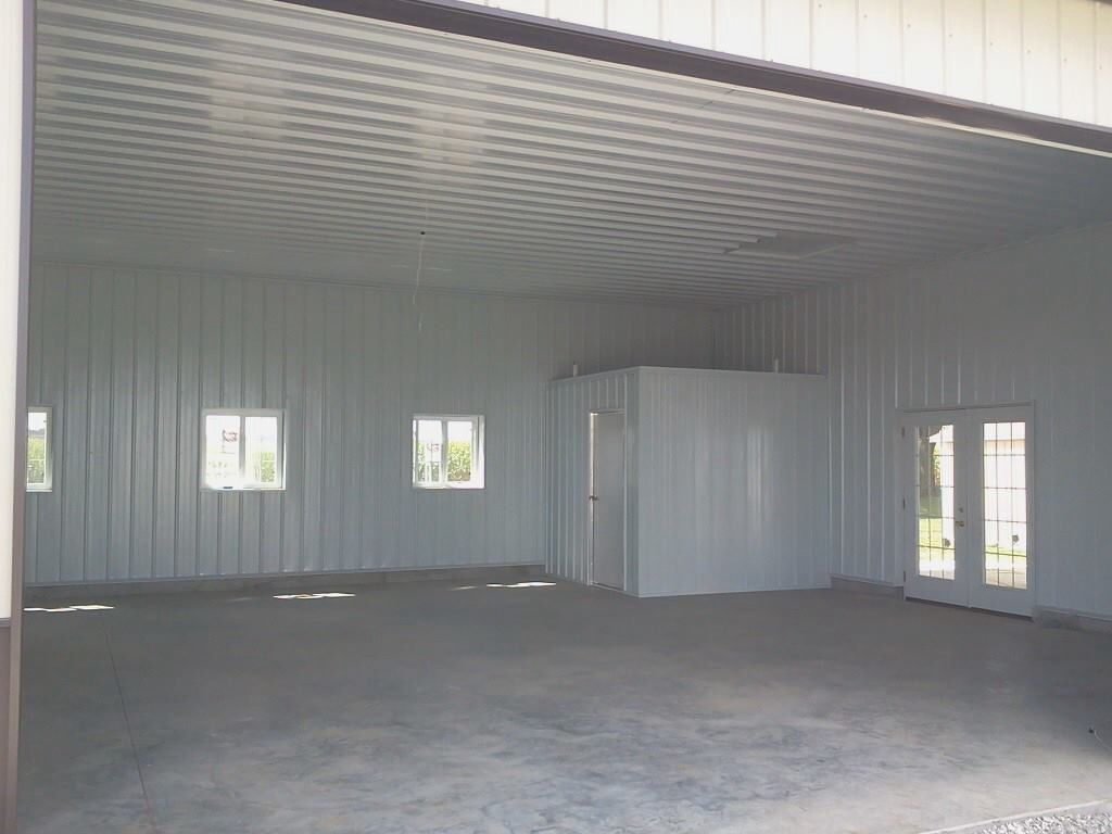 Pole barn finished with metal liner kit outbuilding for Metal building interior ideas