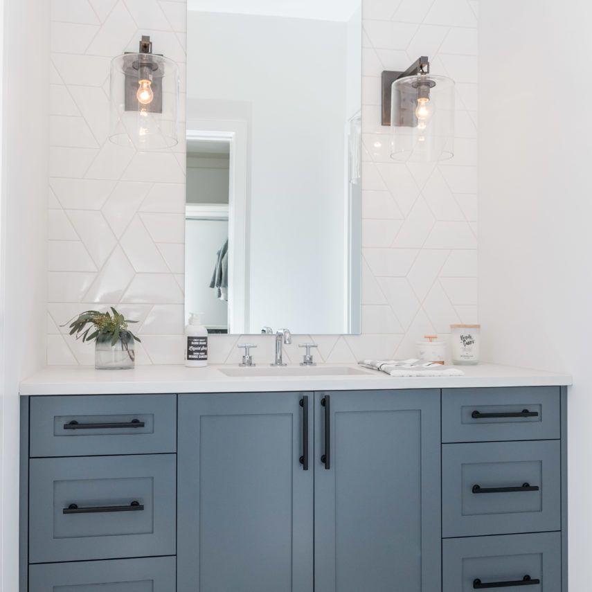 Liberty Interior Design Portfolio Winnipeg Modern Bathroom With Geometric Backsplas Blue Bathroom Interior Bathroom Interior Design Bathroom Decor
