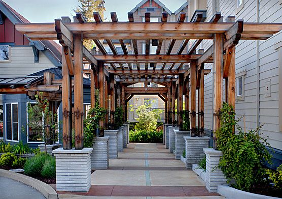 Trellis Design Ideas metal garden trellis exterior inspiration inspiring stacked stones plants pottery added soft painted metal trellis design Craftsman Trellis Design Google Search