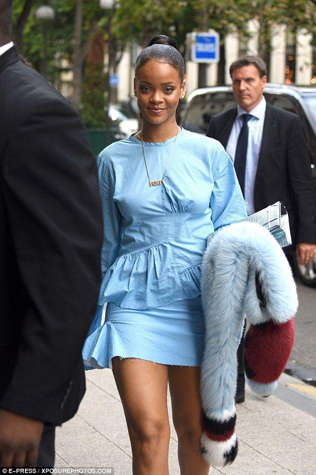 Rihanna Flaunts Her Figure In A Stylish Denim Dress In