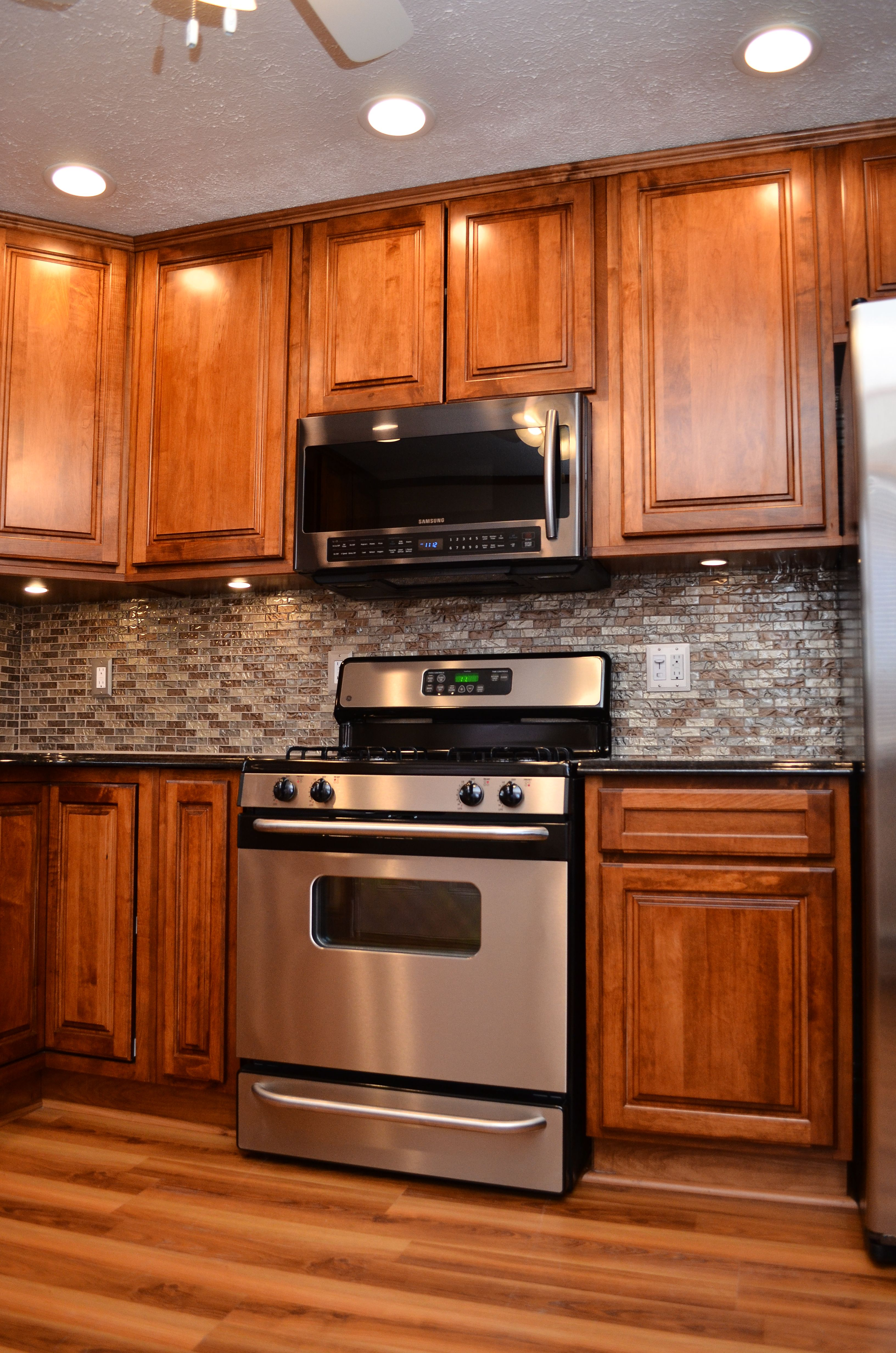 Haas Signature Madison Square Maple Pecan Kitchen Remodel Kitchen Remodeling Projects Maple Cabinets