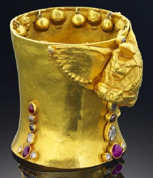 Gold, diamond and ruby 'Lion of Judah', cuff bangle, Sah Oved, 1936. The cuff with the modelled Lion of Judah to one side with one wing doubling up as the clasp and opening to reveal the following inscription, 'I rocked Jacob to his dream of Eternity, my ribs were the ascending ladder for his angels, my head his stony pillow, and when he grew in stature to wrestle with a heavenly being my wings were scythes and my breath like a whirl-wind fought for him', unsigned. #Oved #vintage #cuff