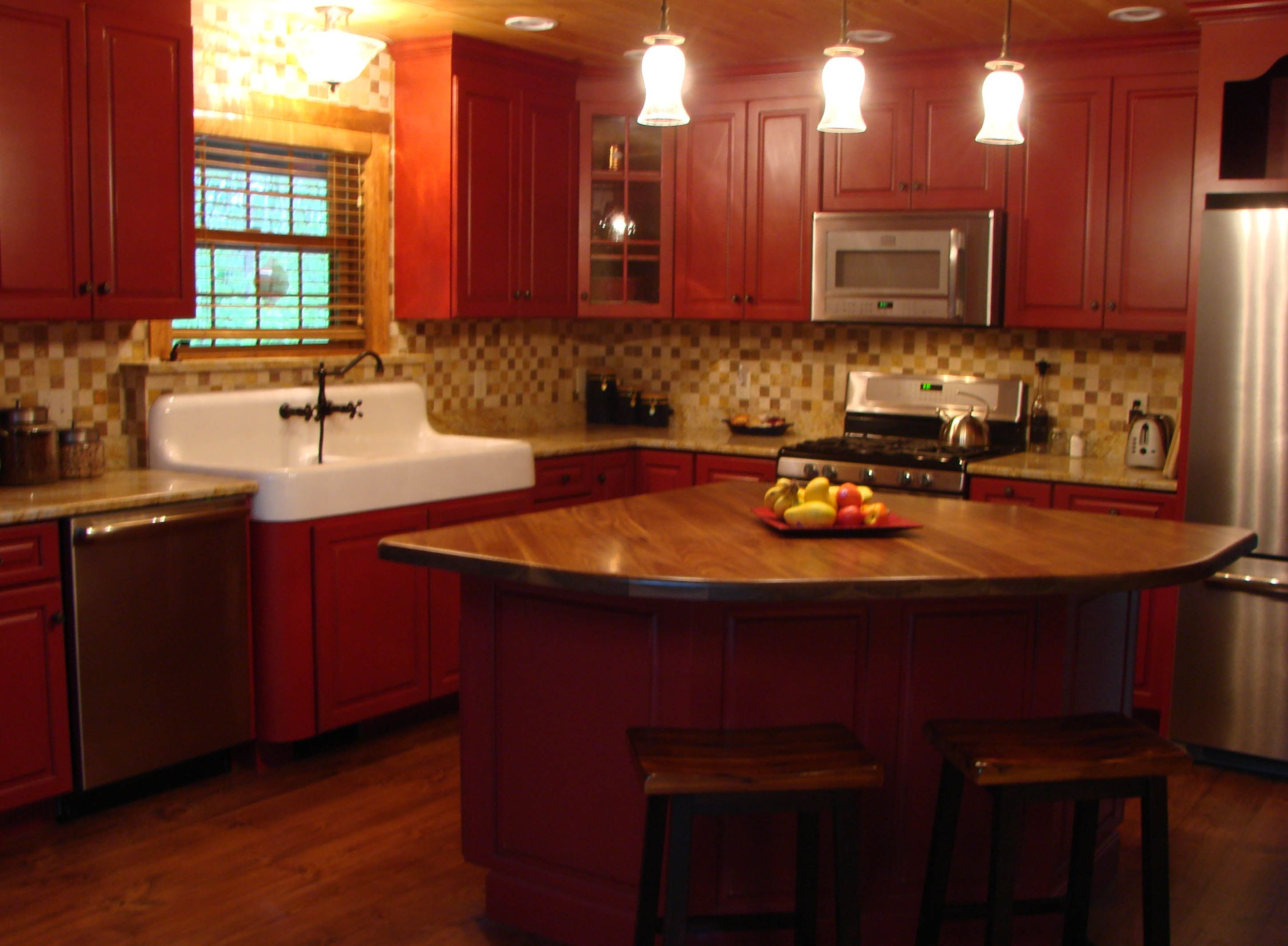Custom Kitchen Painted Red Cabinets With Distressing And Wear Through Finish Black Walnut Isl Distressed Cabinets Kitchen Design Chalk Paint Kitchen Cabinets