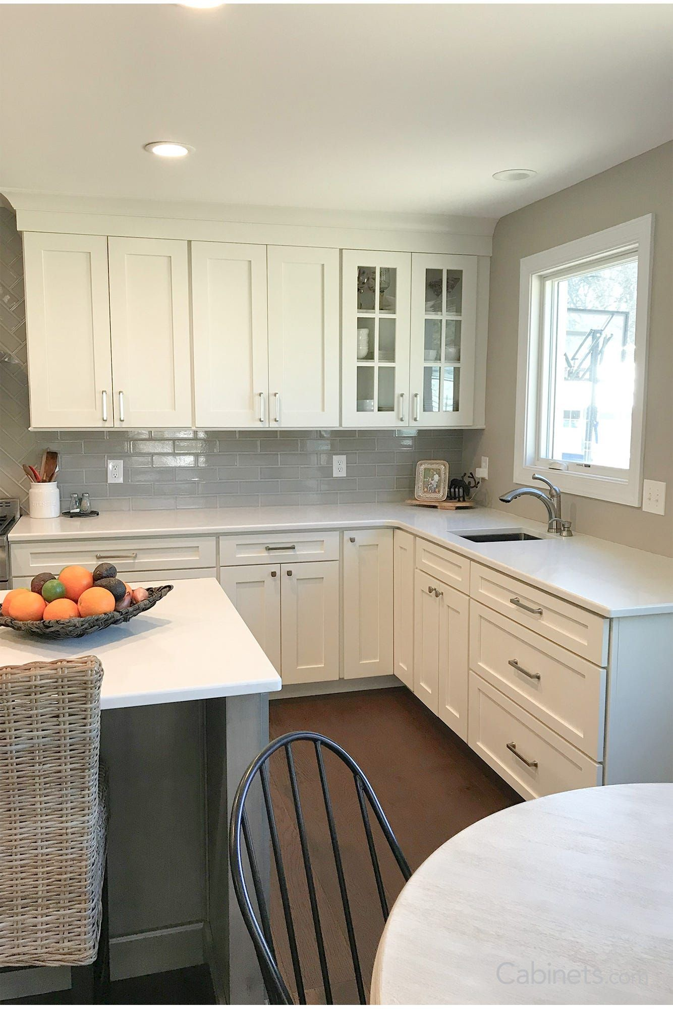 twotone shaker kitchen with mullion glass doors and wine