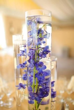 Diy Table Centerpiece Setup With Purple Flowers Inside A Cylinder