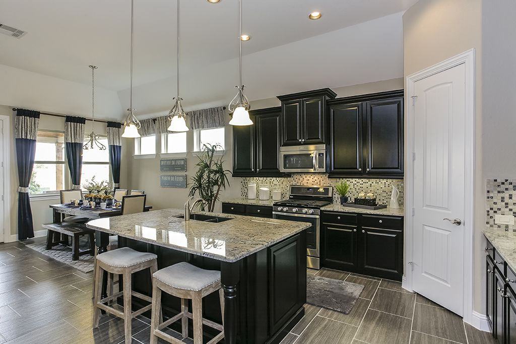 Ordinaire Gehan Homes Kitchen   Black Cabinets, Light Granite Counter Tops, Grey Tile  Floor, Stainless Steel Appliances   Houston, Texas | Westover Park Premier  ...