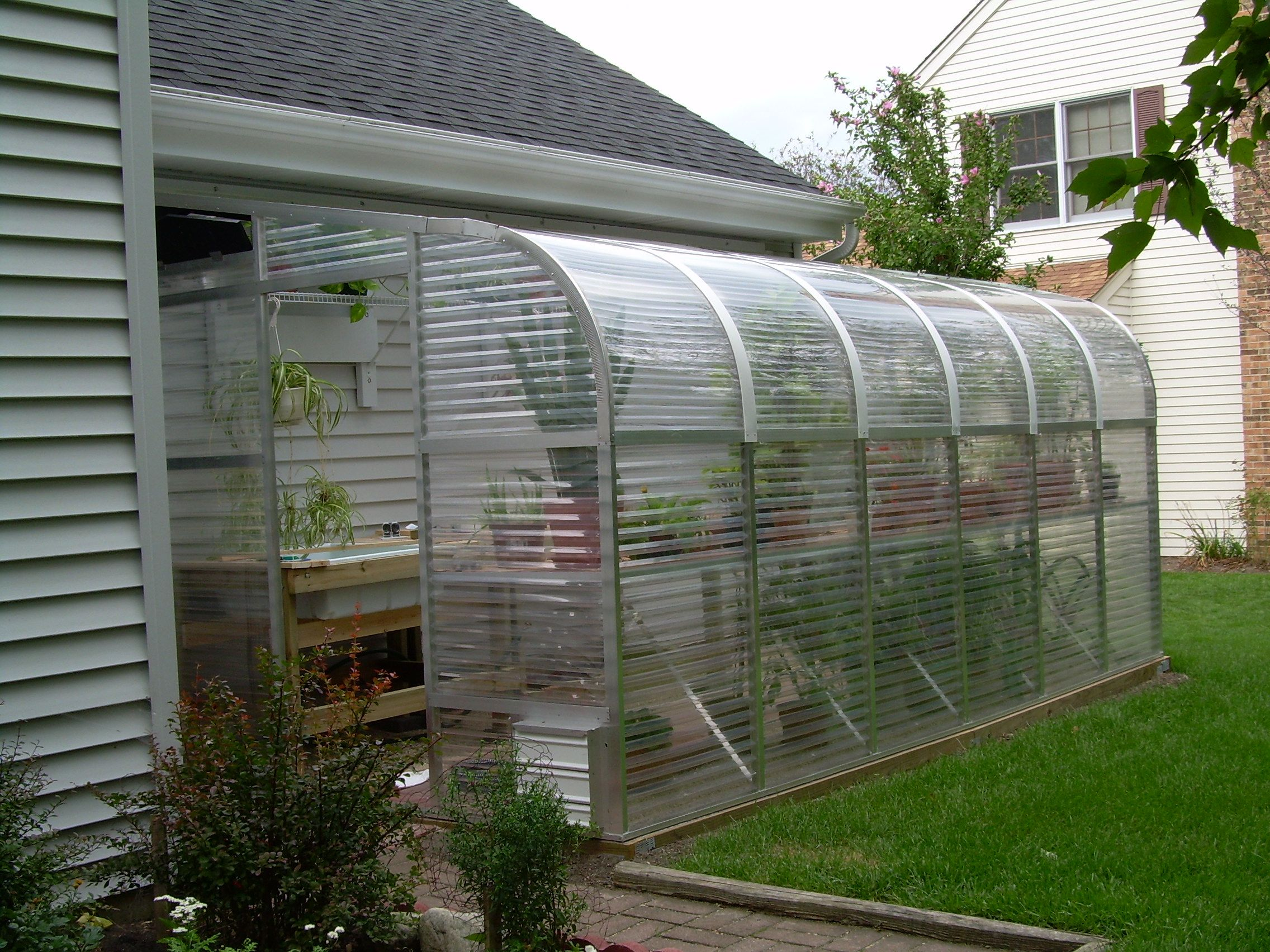a beautiful 10 year old 1700e lean to sunglo greenhouse in il