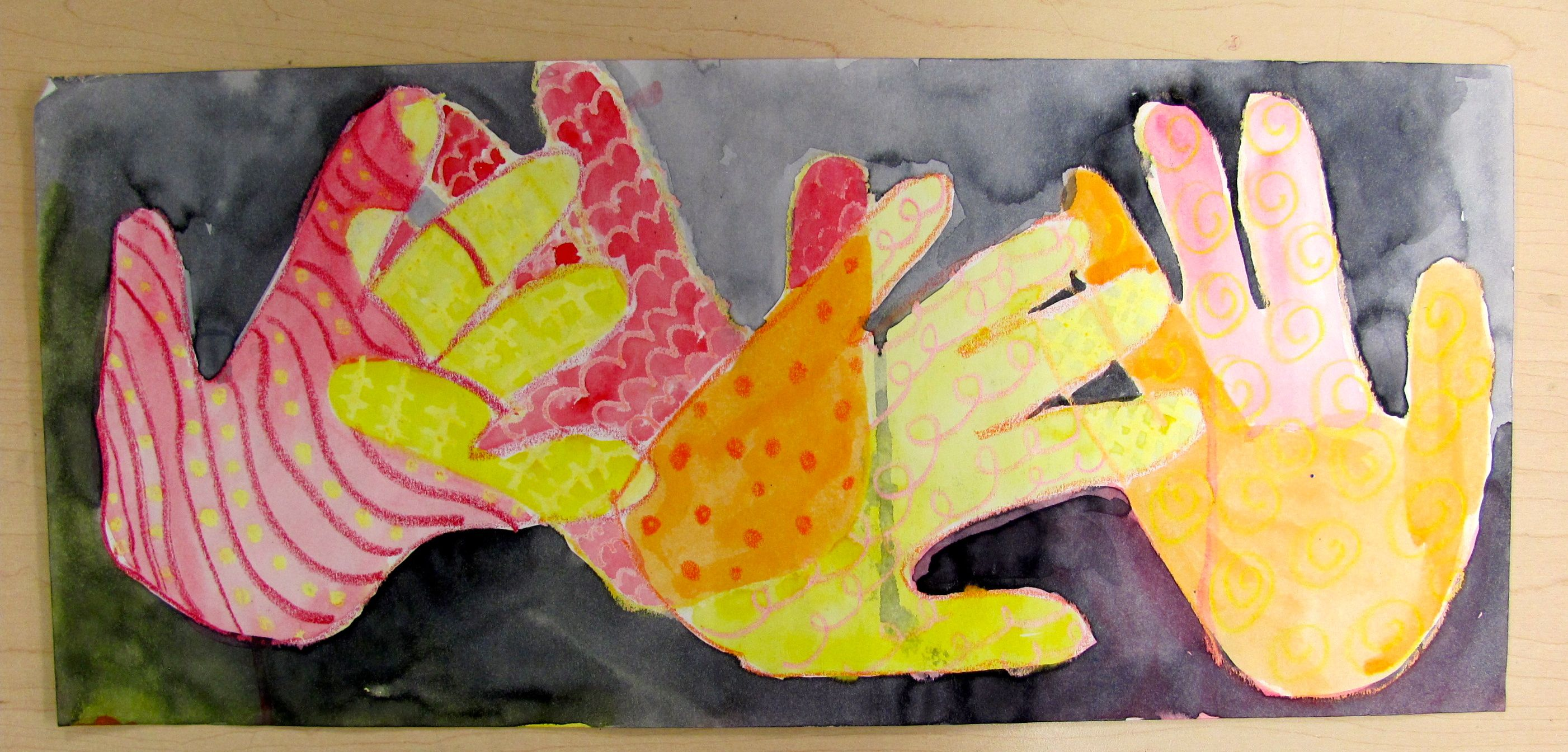 Grade 2 Hands and pattern. 8x18 paper warm colored crayons, liquid watercolor.