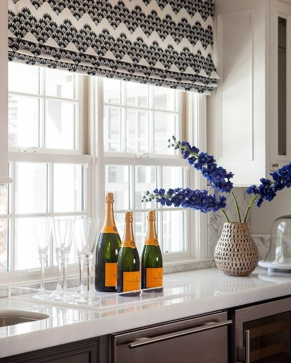 Beautiful Kitchen Boasts Sash Windows Dressed In Black And White Patterned Roman  Shades Over An Undermount