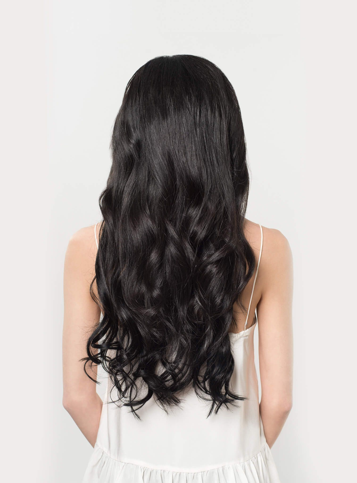 Instantly transform your hair with jet black clipin luxy hair
