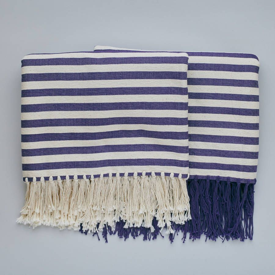 Natural cotton blanket in nautical stripes handwoven by women at Rosecraft Weaving in Swaziland.Available in red, purple, green and turquoise with either cream or coloured tasselsRosecraft Weaving is a social enterprise that provides skills development and an income source to many rural women within Swaziland. Every part of their process is 'by hand' using natural fibres including mohair, cotton, merino and bamboo. affiliate link
