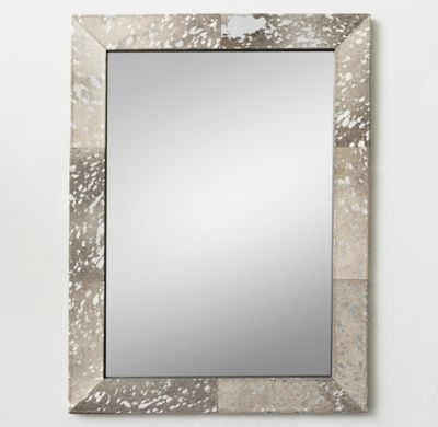 RH TEEN's Metallic Hide Dresser Mirror:Covered in hair-on hide and finished with a metallic silver splatter, our mirror captures the call of the wild. Natural variations in hide color, length and texture make each mirror a one-of-a kind design.