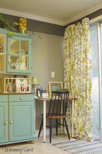 Curtains, desk, & aqua hutch.