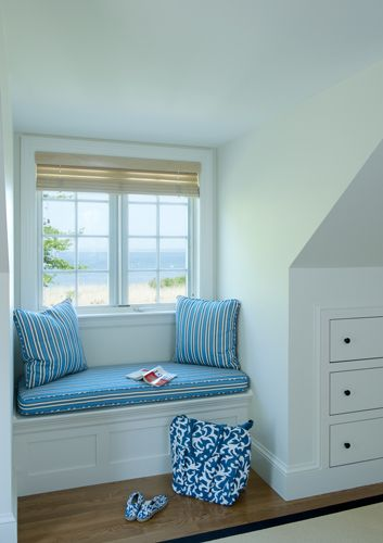 Simple window seat does a lot for the dormer..built in dresser drawers good use of dead space ...
