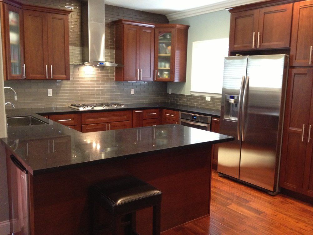 Cherry kitchen cabinets with gray wall and quartz for Kitchen ideas with porcelain countertops