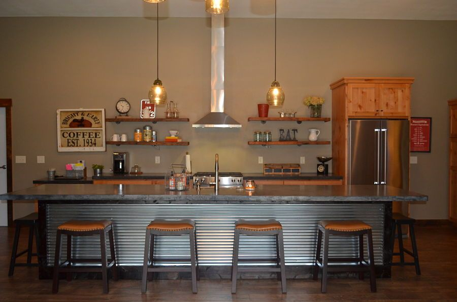 This custom kitchen is inside a post frame home by ...