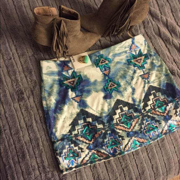 Express Size Medium Sequin Aztec Print Skirt Worn once Express skirt with Aztec print. Sequined skirt is white, blue, Aqua, and cooper colored. Elastic waist band for stretch. Non see thru with a slip attached on the inside. Size medium for reference I'm 5  foot 7 inches its a mini skirt but not too short. Express Skirts Mini