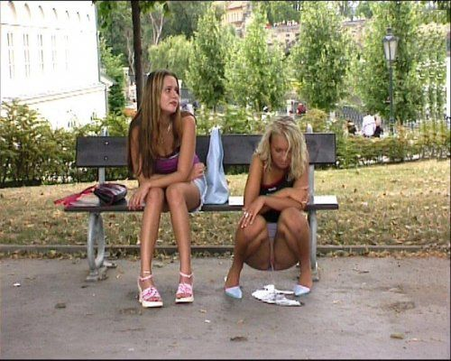 Teen girls peeing outside