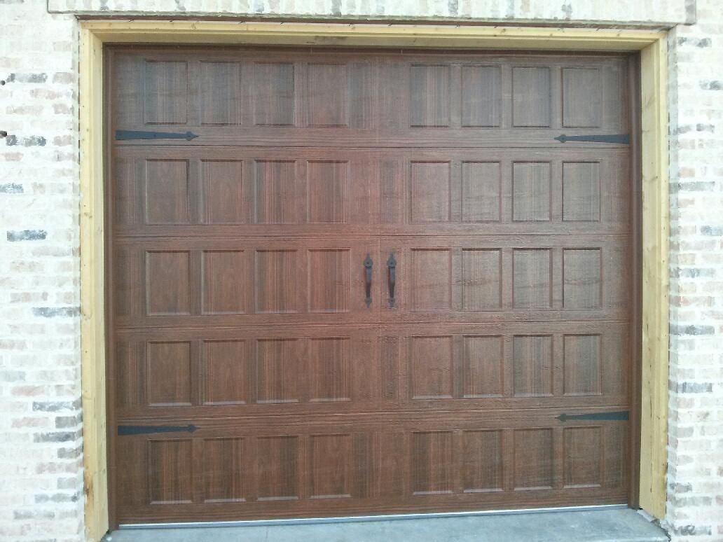 I Absolutely Love The Look Of This Garage Door It Appears As If It Is Made Of Wood And Has A Lot Of History To It Garage Doors New Homes Tall Cabinet